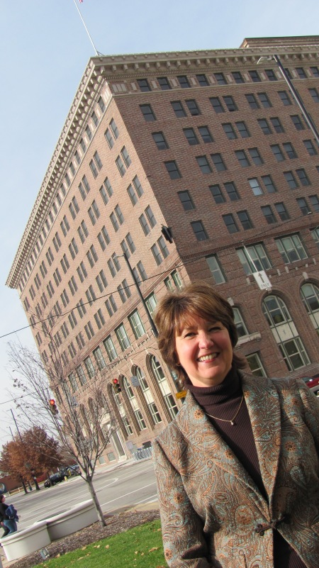 Kathy Lind-Ison, vice president of affordable living for Episcopal Retirement Services (ERS) in front of Central Parkway Place, built inside the Central Parkway YMCA in downtown Cincinnati.